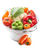 Colorful vegetables in colander isolated. Over white Royalty Free Stock Photos