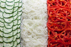 Colorful vegetables cucumber, onion, paprika grouped like the italian flag Stock Photo