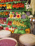 Colorful vegetables,fruits and beans. Fresh vegetables, beans, honey and fruits at a farmer's market Stock Image
