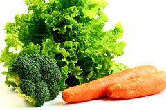 Colorful vegetables, greens and oranges Royalty Free Stock Photography