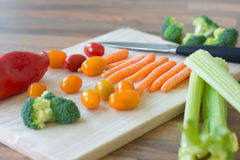 Colorful vegetables in modern kitchen interior Stock Photos