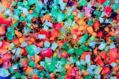Colorful vegetables in the process of stewed in olive oil. Finely chopped different and colorful vegetables in the process of stewed in olive oil in a frying pan Royalty Free Stock Image