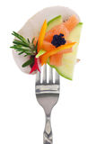 Colorful vegetables, salmon and caviar on fork Stock Photography