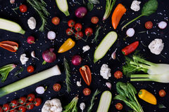 Colorful vegetables and spices on black background. Produce display. Organic healthy vegetarian foods. Farmers market layout. Top Royalty Free Stock Image