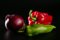 Colorful vegetables still over black Royalty Free Stock Photos