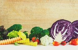 Colorful vegetables and wood background. Colorful vegetables and wood board background Royalty Free Stock Photos