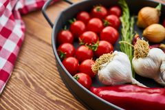 Red Tomatoes and Garlics in Cooking Pot