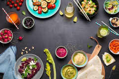 Colorful vegetarian feast dinner table from above. (top view). Healthy diet or lifestyle concept. Flat lay composition with free text space. Black chalkboard as royalty free stock images