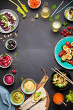 Colorful vegetarian feast dinner table from above. (top view). Healthy diet or lifestyle concept. Flat lay composition with free text space. Black chalkboard as royalty free stock photography
