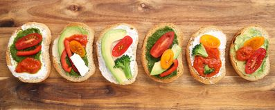 Sandwiches. Colorful vegetarian sandwiches on a wooden chopping board. Healthy food Stock Photos