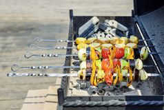 Colorful vegetarian vegetable skewers with roasted bell peppers, onions, eggplants, tomatoes and zucchini stock photo