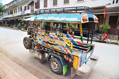 Colorful vehicle on the street in Laos Stock Photography