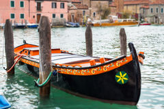 Colorful venetian gondola boat parked in the water Royalty Free Stock Photo