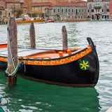 Colorful venetian gondola boat parked in the water Royalty Free Stock Photography