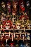 Colorful Venetian Masks. A stand full of colorful Venetian masks. Was hot at Venice, Italy stock images