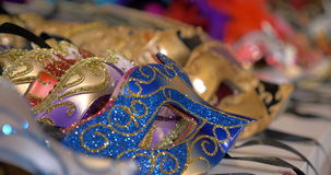 Colorful Venetian masks on the shop counter stock video footage