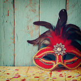 Colorful Venetian masquerade mask. selective focus. vintage filtered Stock Photo