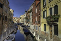 Colorful Venice canal. A view looking along one of the many canals of Venice, Italy on a bright, sunny day Royalty Free Stock Images