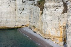 Colorful limestone cliffs with beach near Etretat in Normandie France Royalty Free Stock Photos