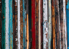Colorful vertical lines, pile of wooden doors. Cracked old paint on wood Royalty Free Stock Image