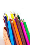 Colorful vertical pencil crayon border over white Royalty Free Stock Photos