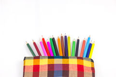 Colorful vertical pencil crayon border over white Royalty Free Stock Images