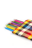 Colorful vertical pencil crayon border over white Royalty Free Stock Photography