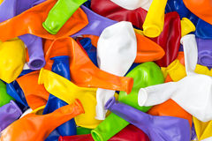 Colorful vibrant background of party balloons. Colorful vibrant background of a pile of deflated party balloons in the colors of the rainbow or spectrum for a Stock Image