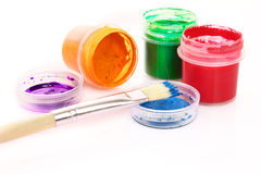 Colorful vibrant cans of gouache and brush Stock Images