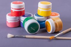 Plastic cans of paint and gouache. Art tools. stock photography