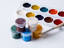 Colorful aquarelle paints in a box and brushes Royalty Free Stock Photos