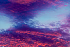 Colorful vibrant clouds on sky at sunset Royalty Free Stock Photography