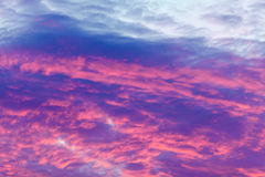 Colorful vibrant clouds on sky at sunset Stock Photo