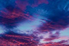 Colorful vibrant clouds on sky at sunset Royalty Free Stock Photos