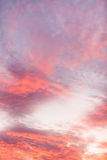 Colorful vibrant clouds on sky at sunset Stock Photography