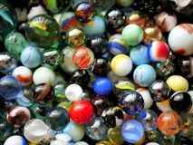 Colorful Vibrant Glass Marbles and Beads in Toy Box royalty free stock images