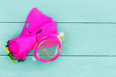Colorful vibrant pink kids goggles and flippers Royalty Free Stock Image
