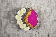 A colorful and vibrant smoothie bowl. Organic, colorful, vibrant smoothie bowl made with fresh and healthy ts and veggies will invigorate your cells with Royalty Free Stock Image