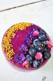 A colorful and vibrant smoothie bowl. Organic, colorful, vibrant smoothie bowl made with fresh and healthy ts and veggies will invigorate your cells with Stock Images
