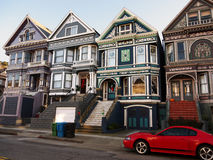 Colorful Victorian houses in San Francisco. Four similar victorian houses beautifully painted and decorated. Wide stairs lead to the entrances Stock Photo