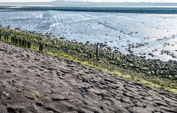 Colorful view at a Dutch breakwater in an estuary from close Stock Photo