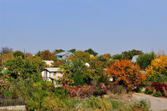 Colourful Village and red leaves Royalty Free Stock Photography