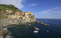 Colorful village of Manarola with fisher boats on the foreground, Cinque Terre stock image
