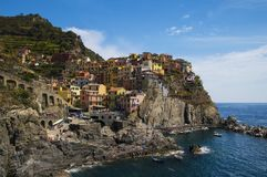 A colorful village by the sea. Manarola, one of five villages in Cinque Terre, Italy, perhaps the most beautiful and interesting one Royalty Free Stock Photos