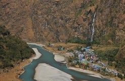 Colorful village Tal, waterfall and Marsyangdi river Royalty Free Stock Photo