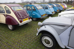 Colorful Vintage cars Citroen 2 CV. Utrecht, Netherlands, march 9 2017:: Colorful Vintage cars Citroen 2 CV named Duck on parking place Vechten next to motorway Stock Image