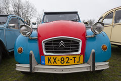 Colorful Vintage cars Citroen 2 CV. Utrecht, Netherlands, march 9 2017:: Colorful Vintage cars Citroen 2 CV named Duck on parking place Vechten next to motorway Royalty Free Stock Image