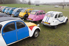 Colorful Vintage cars Citroen 2 CV. Utrecht, Netherlands, march 9 2017:: Colorful Vintage cars Citroen 2 CV named Duck on parking place Vechten next to motorway Stock Photography