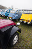 Colorful Vintage cars Citroen 2 CV. Utrecht, Netherlands, march 9 2017:: Colorful Vintage cars Citroen 2 CV named Duck on parking place Vechten next to motorway Stock Images