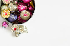 Colorful Vintage Christmas ornaments in iron pot on white backgr Stock Photo